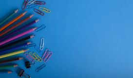 Color pencils on blue background stock photos