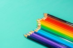 Color pencils on blue background Stock Photo