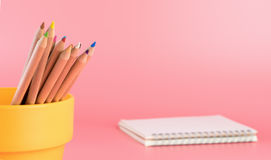 Color pencils in bucket with notebook Stock Photography