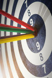 Color pencils in bull's eye Success hitting target aim goal achi. Evement concept background Royalty Free Stock Image