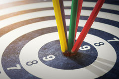 Color pencils in bull's eye Success hitting target aim goal achi. Evement concept background Stock Photography
