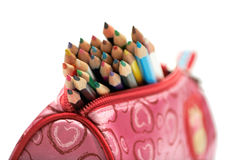 Color pencils in the case. Close up of school supplies in pencil case on white background Stock Image