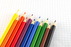 Color pencils on the checked paper Stock Images