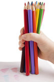 Color pencils in child hand Stock Photo