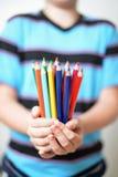 Color pencils in children's hands Stock Photos