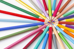 Color pencils in a circle on white background. Many different color pencils on white background Royalty Free Stock Photo