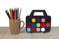 Color pencils in coffee cup,  table Royalty Free Stock Images