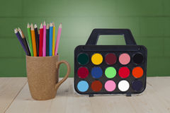 Color pencils in coffee cup,  table Stock Photography