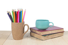 Color pencils, coffee cup on wooden Stock Photo