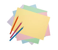 Color pencils and colorful paper Royalty Free Stock Photography