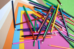 Color pencils with colorful paper sheets Stock Photography