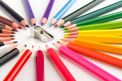 Color pencils composition with sharpener Stock Photos