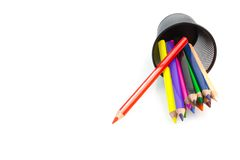 Color pencils and container Royalty Free Stock Photos
