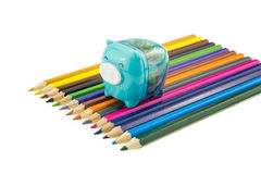 Color pencils and cute sharpener Royalty Free Stock Images