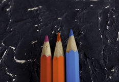 Color pencils on dark background. Colored pencils on dark background basis Stock Images