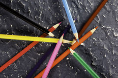 Color pencils on dark background. Colored pencils on dark background basis Stock Photography