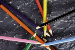 Color pencils on dark background. Colored pencils on dark background basis Royalty Free Stock Photos
