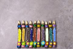 Color pencils decorated with threads and flowers, isolated on grey background. Back to school, education banner. Back to school and education banner with royalty free stock photography