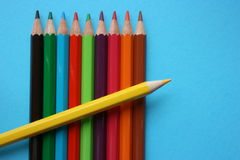 Color pencils of different colors. Yellow color pencil put on top of other color pencils Royalty Free Stock Photos