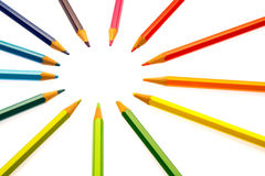Color pencils of different colors. Making a color wheel on white background Royalty Free Stock Images