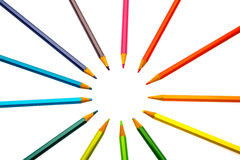 Color pencils of different colors. Making a color wheel on white background Royalty Free Stock Photo