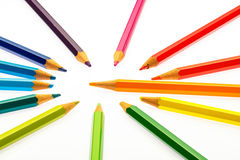 Color pencils of different colors. Making a color wheel on white background Stock Photos
