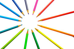 Color pencils of different colors. Making a color wheel on white background Royalty Free Stock Image