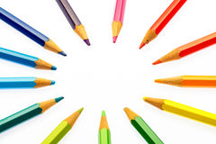 Color pencils of different colors. Making a color wheel on white background Stock Image
