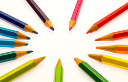 Color pencils of different colors. Making a color wheel on white background Royalty Free Stock Photos