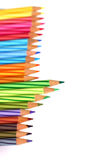 Color pencils forming border. Going green - Row of coloring pencils forming a border or half frame with copyspace. clean white background. Image can be used for Royalty Free Stock Images