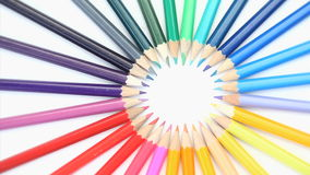 Color pencils forming a circle rotating stock video footage