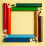 Color pencils forming a square frame Royalty Free Stock Image