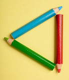 Color pencils forming a triangle frame Royalty Free Stock Photo