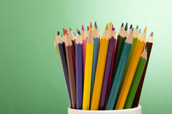 Color pencils on green background Stock Photo