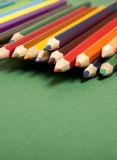 Color pencils on green background Royalty Free Stock Photography