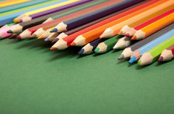 Color pencils on green background Royalty Free Stock Photo