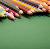 Color pencils on green background Stock Photography