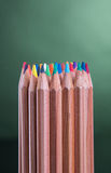 Color pencils with green background Royalty Free Stock Images