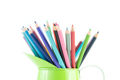 Color pencils in Green Cup. Group of pencil crayons in green metal pitcher isolated on white background Stock Images