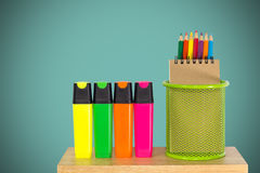 Color pencils in a green holder basket with marker pens. Multi color pencils in a green holder basket with marker pens Stock Images
