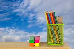 Color pencils in a green holder basket with marker pens. Multi color pencils in a green holder basket with marker pens Royalty Free Stock Image