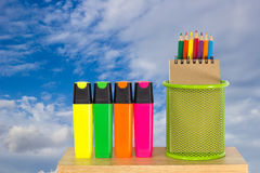 Color pencils in a green holder basket with marker pens Stock Photos
