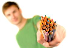 Color pencils in hand Stock Photos