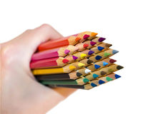 Color pencils in hand Stock Images