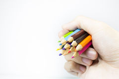 color pencils in hand on isolated background Royalty Free Stock Photos