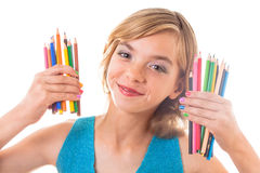 Color pencils in hands. Color rainbow pencils and teenager hands with multicoloured nails Stock Images