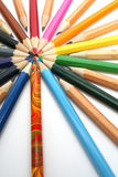 Color pencils have settled down around of the colour leader Royalty Free Stock Photo
