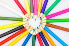 Color pencils with a heart circle. Bunch of colored pencils isolated on white background Royalty Free Stock Photo