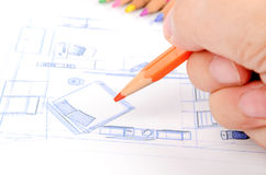 Color pencils and house blueprint Stock Photography