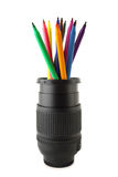 Color pencils inside of camera lens Royalty Free Stock Images